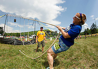 "Karen Longfellow on team ""Bat Girls"" makes her fellow team mates proud during the ""Keg Hoist"" event in the Craft Beer Relay at Gunstock Mountain Resort on Saturday.  (Karen Bobotas/for the Laconia Daily Sun)"