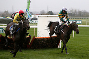 Winner - Supasundae and Robbie Power (red cap) and second placed Buveur D'Air with Barry Geraghty (white cap) battle it out at the last hurdle in the 3.25pm The Betway Aintree Hurdle (Grade 1) 2m 4fduring the Grand National Festival Week at Aintree, Liverpool, United Kingdom on 4 April 2019.