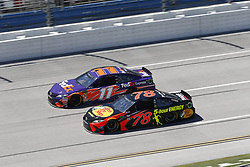 April 29, 2018 - Talladega, Alabama, United States of America - Denny Hamlin (11) and Martin Truex, Jr (78) battle side by side down the front stretch for position during the GEICO 500 at Talladega Superspeedway in Talladega, Alabama. (Credit Image: © Justin R. Noe Asp Inc/ASP via ZUMA Wire)