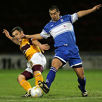 Motherwell v St Johnstone..Scottish Cup....28.02.2007<br /> Allan McManus tackles Scott McDonald<br /> <br /> Picture by Graeme Hart.<br /> Copyright Perthshire Picture Agency<br /> Tel: 01738 623350  Mobile: 07990 594431