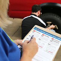 """Denieta Cantrell, Human Resource Manager at Cooper Tire, takes down tire pressure information as Micheal Autry, a tire engineer at Cooper Tire, calls out the air pressure reading as they preform """"Tread Wisely"""" a tire safety check Tuesday morning at the Cooper Tire Plant in Tupelo. Tread Wisely is a vehicle saftey program sponsored by Cooper with checks being conducted by Cooper Tire employees who are trained volunteers. They spread out in the employee parking lots to perform the saftey checks on tires of their co-workers. Those who signed up and had their tires checked received a written report as well as a free tire safety kit and a special discount on a future tire purchase at Cooper Service in Tupelo. The tire safety checks will be for two days, May 22 and 23."""