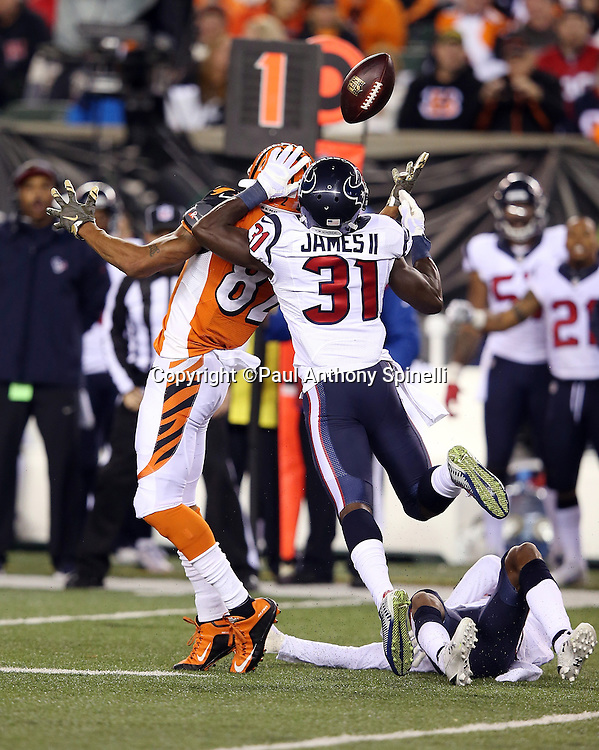 Houston Texans defensive back Charles James (31) breaks up a pass play intended for Cincinnati Bengals wide receiver Marvin Jones (82) during the 2015 week 10 regular season NFL football game against the Cincinnati Bengals on Monday, Nov. 16, 2015 in Cincinnati. The Texans won the game 10-6. (©Paul Anthony Spinelli)