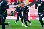 Swansea City forward Andre Ayew (22) warming up during the EFL Sky Bet Championship match between Barnsley and Swansea City at Oakwell, Barnsley, England on 19 October 2019.