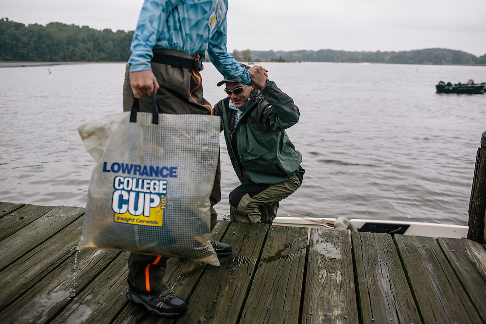 Billy Arens, left, of Shenandoah University helps his brother and teammate Thomas back onto the dock during the FLW College Fishing Northern Conference Invitational in Marbury, MD on Oct. 11, 2014. Only the top 15 of 43 teams moved on to Sunday.