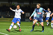 Tranmere Rovers defender Jake Caprice (14) on defensive duties under pressure from Wycombe Wanderers striker Alex Samuel (25) during the The FA Cup match between Wycombe Wanderers and Tranmere Rovers at Adams Park, High Wycombe, England on 20 November 2019.