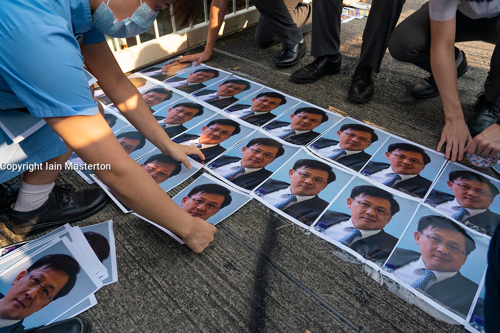 Wanchai, Hong Kong. 26 September, 2019. Human chain formed by students from local secondary schools in Hong Kong to support the pro democracy movement and anti-extradition bill. Local school students stick photos of Julius Ho to footbridge.