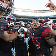 10 September 2016: The San Diego State Aztecs football team hosts Cal in their second game of the season.  San Diego State running back Donnell Pumphrey (19) leads the Aztecs onto the field prior to the start of the game against Cal. The Aztecs lead 31-21 at halftime.