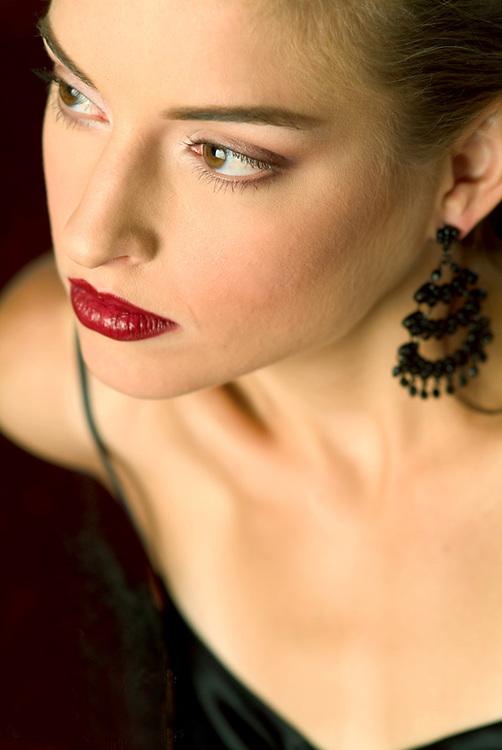 Close-up beauty portrait of brunette girl