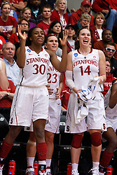 March 21, 2011; Stanford, CA, USA; Stanford Cardinal forward Nnemkadi Ogwumike (30), guard Jeanette Pohlen (23) and Stanford Cardinal forward Kayla Pedersen (14) cheer from the bench during the second half of the second round of the 2011 NCAA women's basketball tournament against the St. John's Red Storm at Maples Pavilion. Stanford defeated St. John's 75-49.