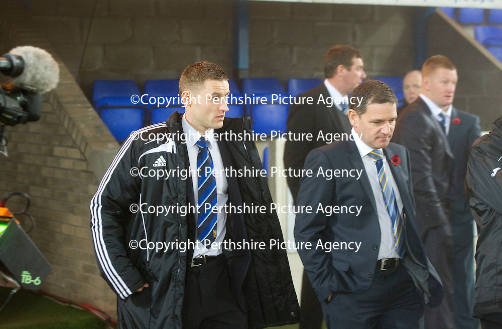 St Johnstone v Aberdeen game called off due to thick fog at McDiarmid Park in Perth....07.11.11<br /> Ref Steven McLean arrives at McDiarmid Park with Chairman Steve Brown before calling the game off<br /> Picture by Graeme Hart.<br /> Copyright Perthshire Picture Agency<br /> Tel: 01738 623350  Mobile: 07990 594431