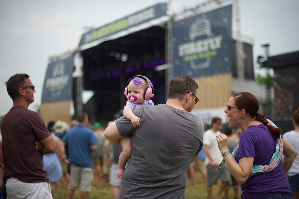 Sophia Malais, 8 months, accompanies her parents Cyndi and Constantine to The Griswolds performance during the Firefly Music Festival in Dover, Delaware June 20, 2015.  According to organizers, attendance exceeded 90,000 for the four day festival, which featured more than 110 acts, and was set in 105 acre grounds of the Dover International Speedway.