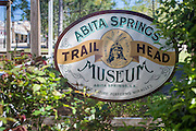 Abita Springs Trailhead Museum sign alongside the Tammany Trace