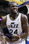 Utah Jazz power forward Paul Millsap (24) reacts after getting fouled during the second half of an NBA basketball game against the Orlando Magic in Salt Lake City, Friday Dec. 10, 2010. The jazz defeated the Magic 117-105. (AP Photo/Colin E Braley)