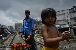 July 18, 2017 - Dhaka, Bangladesh - Slum people next to railway tracks at kawranbazar area on July 18, 2017 in Dhaka, Bangladesh. Hundred of low income families come from the countryside to Dhaka for a better life. (Credit Image: © Syed Mahamudur Rahman/NurPhoto via ZUMA Press)