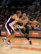 Feb. 2, 2011; Phoenix, AZ, USA; Milwaukee Bucks forward Corey Maggette (5) handles the ball against the Phoenix Suns forward Grant Hill (33) at the US Airways Center. Mandatory Credit: Jennifer Stewart-US PRESSWIRE