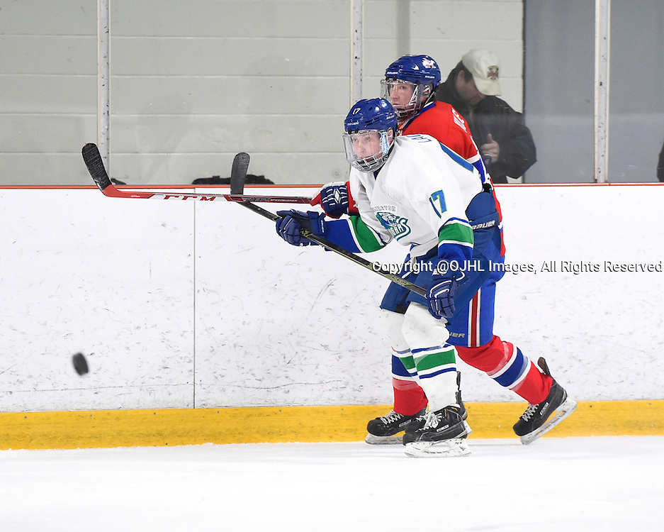 BURLINGTON, - Mar 2, 2016 -  Ontario Junior Hockey League game action between Burlington Cougars and the Toronto Junior Canadians. Game 1 of the first round playoff series at the Appleby Ice Centre, ON. Philip Lagunov #17 of the Burlington Cougars keeps the puck from Andrew Mullen #10 of the Toronto Jr. Canadiens during the third period.<br /> (Photo by Andy Corneau / OJHL Images)