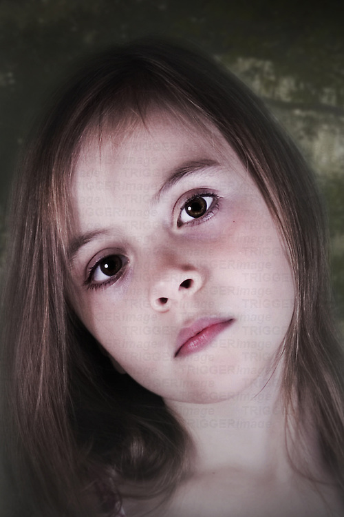 young child with large eyes looking at the camera