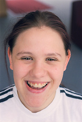Portrait of young woman at day centre for homeless and vulnerably housed young people,