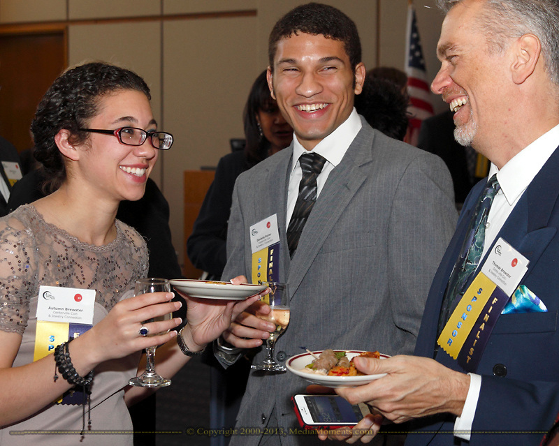 Autumn Brewster of Centerville Coin & Jewelry Connection, Austin McCloud and Thomas Brewster of Centerville Coin & Jewelry Connection during the Better Business Bureau's Eclipse Integrity Awards dinner at Sinclair Community College's Ponitz Center in downtown Dayton, Tuesday, May 14 2013.
