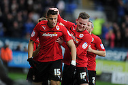 Cardiff city's Rudy Gestede (15) celebrates with teammate Aron Gunnarsson (17) after he scores the opening goal. NPower championship, Cardiff city v Millwall at the Cardiff city stadium in Cardiff, South Wales on Saturday 29th Dec 2012. pic by Andrew Orchard, Andrew Orchard sports photography,