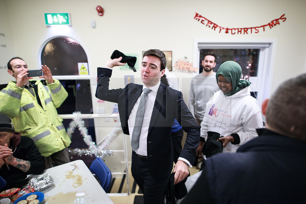 © Licensed to London News Pictures. 02/12/2016. Manchester, UK. Greater Manchester Mayoralty candidate ANDY BURNHAM MP visits the Barnabus homeless centre on Bloom Street in Manchester, and helps to distribute clothes . Barnabus provides food and support for people who sleep rough . In the last week , two people in Manchester and one in Birmingham have died whilst sleeping rough . Photo credit: Joel Goodman/LNP