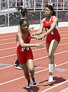 Trotwood's Jameela Henderson (left) takes the handoff from Stella Ross and begins the final lap of the Girls 4x400 Meter Relay during the Buff Taylor Memorial Track & Field Invitational at the Good Samaritan Sports Plex at Trotwood Madison High School, Saturday, May 10, 2008.