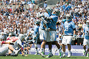 05/25/2014 - Baltimore, Md. - Tufts midfielder Chris Sawyer, A16, right, and Tufts defenseman CJ Higgins, A15, celebrate a score in Tufts' 12-9 win over Salisbury to win the NCAA Division III Men's Lacrosse National Championship game at M&T Bank Stadium on May 25, 2014. (Kelvin Ma/Tufts University)