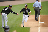 CHICAGO - JUNE 10:  Third base coach Jeff Cox #8 congratulates Omar Vizquel #11 of the Chicago White Sox after Vizquel hit a home run against the Detroit Tigers on June 10, 2010 at U.S. Cellular Field in Chicago, Illinois.  The White Sox defeated the Tigers 3-0.  (Photo by Ron Vesely)