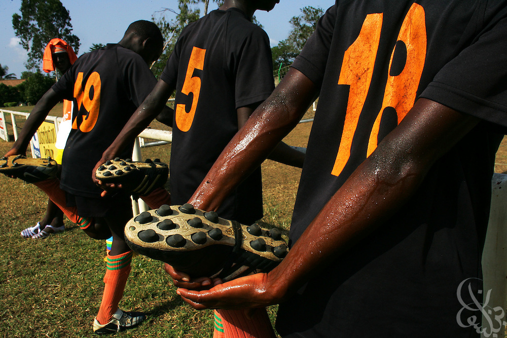 Teenage Ivorian football players stretch out before taking to the pitch for a morning training session at the ASEC football academy February 16, 2006 in Abidjan, Ivory Coast. ASEC academy has an established history of producing top notch footballers who go on to play in the top European football leagues.