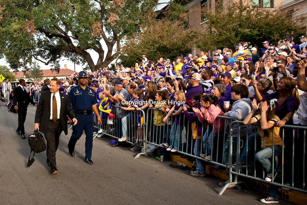 November 13, 2010; Baton Rouge, LA, USA; LSU Tigers head coach Les Miles is greeted by fans outside prior to kickoff of a game between the LSU Tigers and the Louisiana Monroe Warhawks at Tiger Stadium.  Mandatory Credit: Derick E. Hingle