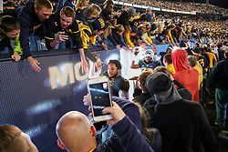 Nov 4, 2017; Morgantown, WV, USA; West Virginia Mountaineers players celebrate with fans after beating the Iowa State Cyclones at Milan Puskar Stadium. Mandatory Credit: Ben Queen-USA TODAY Sports