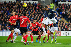 Man Utd Defender Patrice Evra (FRA) heads a corner to score a goal during the first half of the match - Photo mandatory by-line: Rogan Thomson/JMP - Tel: Mobile: 07966 386802 - 24/11/2013 - SPORT - FOOTBALL - Cardiff City Stadium - Cardiff City v Manchester United - Barclays Premier League.