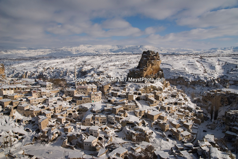Ortahisar, Nevsehir, Cappadocia, Turkey. The village of Ortahisar.  With a hot air balloon of Kapadokya Balloons we glide over the valleys of Goreme National Park. A fresh pack of snow has turned the winter landscape into an even bigger fairy tale. Photo by Frits Meyst/Adventure4ever.com