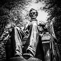Black and white photo of Chicago Abraham Lincoln sitting statue in Grant Park. The statue is named The Head of State and is also known as Seated Lincoln or Sitting Lincoln.
