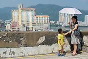 MACAU, CHINA - SEPTEMBER 11, 2013: Unidentified people enjoy the view to downtown Macau in Macau, China.