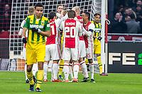 AMSTERDAM - Ajax - ADO , Voetbal , Eredivisie , Seizoen 2016/2017 , Amsterdam ArenA , 29-01-2017 ,  Ajax speler Hakim Ziyech scoort de 1-1 en viert dit terwijl ADO Den Haag speler Achraf El Mahdioui (l) baalt