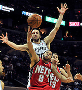 Deron Williams (#8) of the New Jersey Nets fights for a rebound with San Antonio Spurs Manu Ginobili of Argentina during the first half of their game at the ATT Center in San Antonio, Texas, USA, 25 February, 2011.