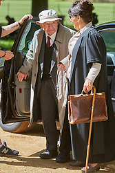 © Licensed to London News Pictures. 19/05/2015. OXFORD, UK. Filming of ITV drama Endeavour, telling the story of the early life of Inspector Morse, taking place in Christ Church Meadow in Oxford. <br /> <br /> In this picture: Author Colin Dexter (centre) arriving on the set<br /> <br /> Photo credit : Cliff Hide/LNP