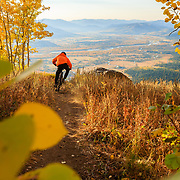 Malachi Artise rides the Ridge Trail at sunrise during peak autumn colors.