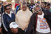 17 JANUARY 2011 - PHOENIX, AZ: Marchers bow their heads in prayer before the annual Martin Luther King Day March in Phoenix, AZ. About 500 people participated the Martin Luther King Jr March through downtown Phoenix, Monday, Jan. 17. PHOTO BY JACK KURTZ