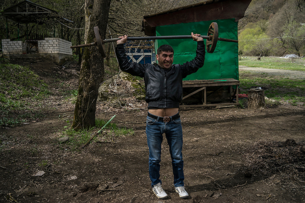 VANK, NAGORNO-KARABAKH - APRIL 22: Arso Poghosyan, 34, jokes around with a weight at a campground during a stop to visit a freshwater spring on April 22, 2015 in Vank, Nagorno-Karabakh. Since signing a ceasefire in a war with Azerbaijan in 1994, Nagorno-Karabakh, officially part of Azerbaijan, has functioned as a self-declared independent republic and de facto part of Armenia, with hostilities along the line of contact between Nagorno-Karabakh and Azerbaijan occasionally flaring up and causing casualties. (Photo by Brendan Hoffman/Getty Images) *** Local Caption ***