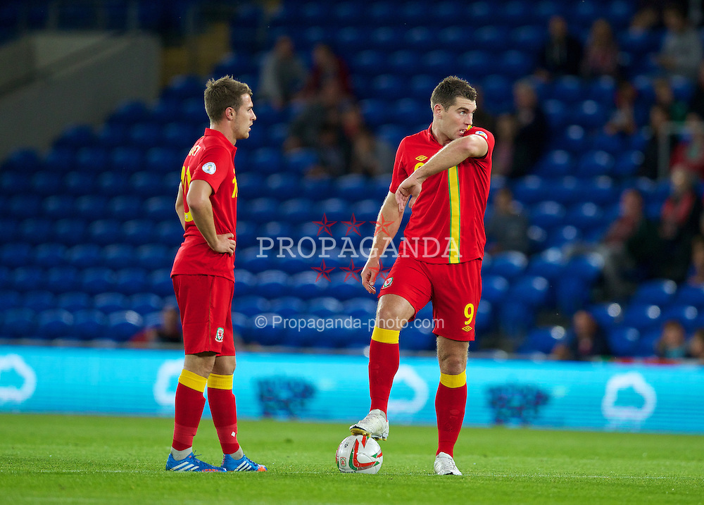 CARDIFF, WALES - Tuesday, September 10, 2013: Wales' Sam Vokes and captain Aaron Ramsey look dejected as Serbia score the opening goal during the 2014 FIFA World Cup Brazil Qualifying Group A match at the Cardiff CIty Stadium. (Pic by David Rawcliffe/Propaganda)