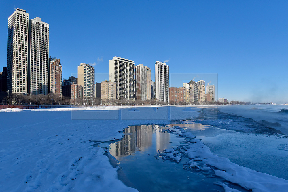 © Licensed to London News Pictures. 27/12/2017. CHICAGO, USA.  Frozen ice is seen on the shoreline near North Avenue Beach. The city of Chicago experiences sub-zero temperatures.  With the effects of wind chill, temperatures are expected to be -22C to -32C.  Photo credit: Stephen Chung/LNP