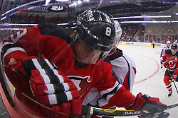Jan 25, 2013; Newark, NJ, USA; New Jersey Devils right wing Dainius Zubrus (8) is hit into the boards during the first period at the Prudential Center.