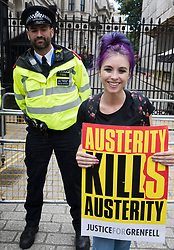 © Licensed to London News Pictures. 01/07/2017. London, UK. A protestor holds a placard outside Downing Street during the People's Assembly anti-austerity demonstration. Photo credit: Peter Macdiarmid/LNP