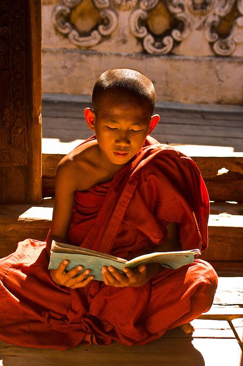 Novice monk reading, Bagayar Monastery, Inwa, Burma (Myanmar)