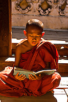 Novice monk reading, Bagayar Monastery, Inwa, Burma (Myanmar)