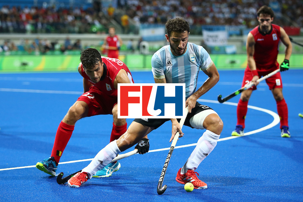 RIO DE JANEIRO, BRAZIL - AUGUST 18:  Manuel Brunet #24 of Argentina competes for the ball with Simon Gougnard #22 of Belgium during the Men's Hockey Gold Medal match between Belgium and Argentina on Day 13 of the Rio 2016 Olympic Games at Olympic Hockey Centre on August 18, 2016 in Rio de Janeiro, Brazil.  (Photo by Clive Brunskill/Getty Images)