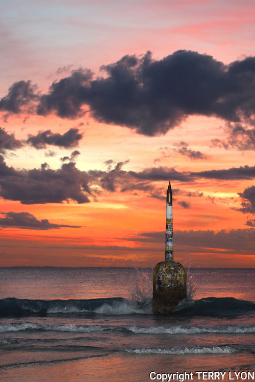 An extreme low tide this evening at sunset where it was almost possible to walk around the Cottesloe Beach Pylon
