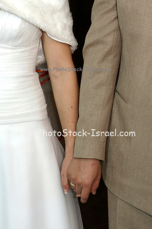 A couple male and female holding hands